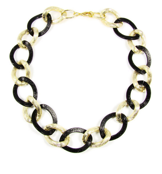 Chain Link Necklace Classic necklace features a golden and black toned chain