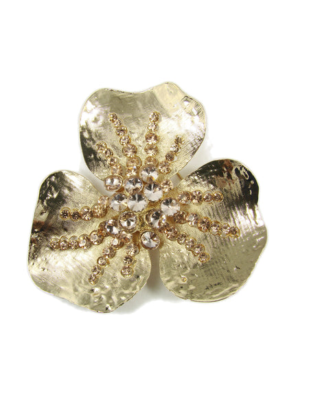 Fashion brooch with a clover motif