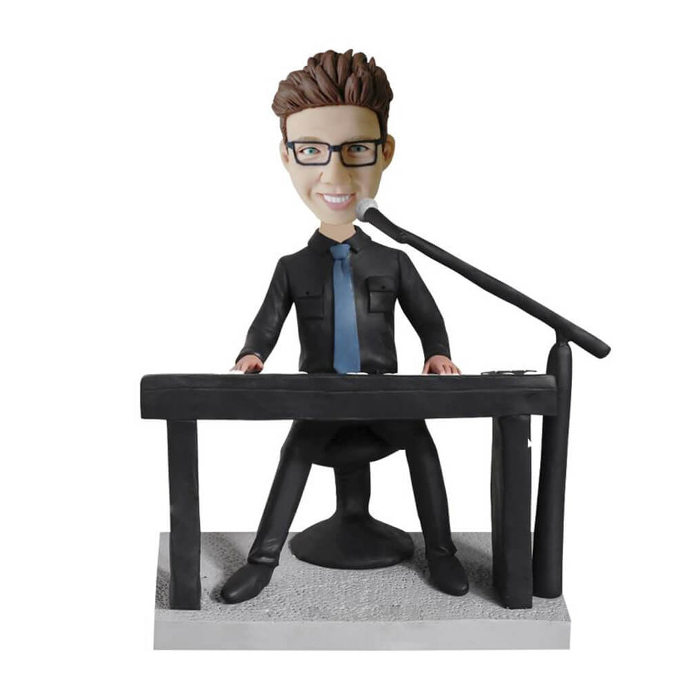 Singer playing piano bobblehead
