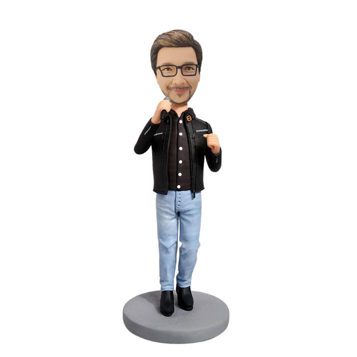 Man holding a microphone bobblehead