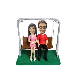 Couple sitting on a swing Bobblehead