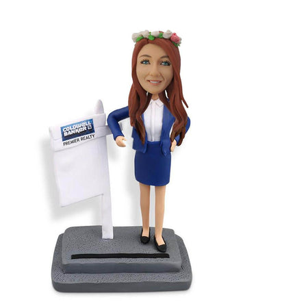 Female real estate agent bobblehead