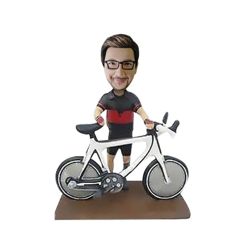 Biker standing behind the bicycle bobblehead