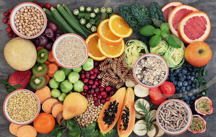 Plant whole foods consisting of organic fruits, vegetables, nuts and seeds for a plant-based diet