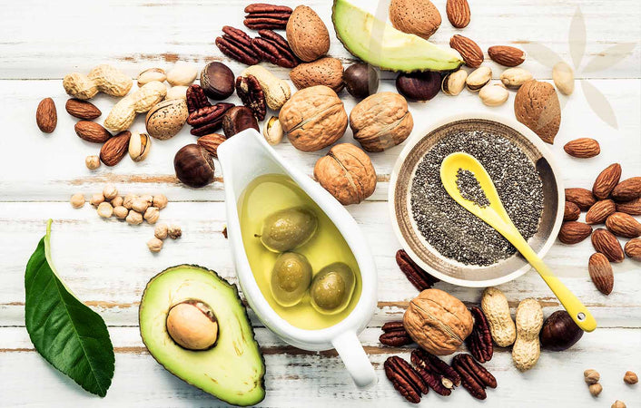 Healthy whole food fats including avocado, nuts, chia seeds & extra virgin olive oil