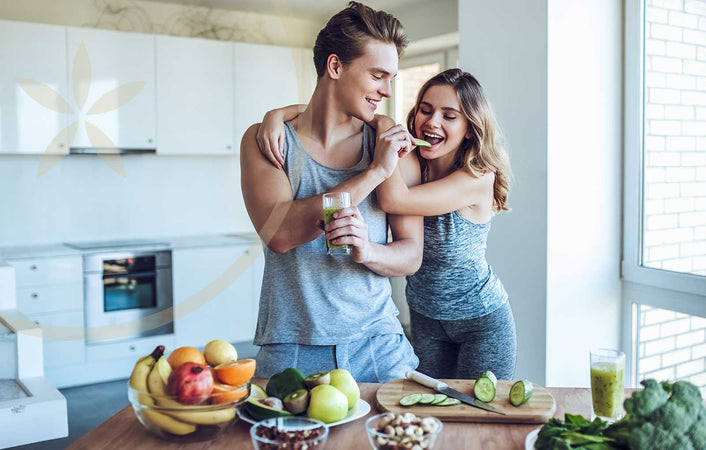 Man and woman eating healthy whole foods that support their endocannabinoid system