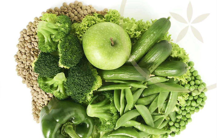 Top digestive system foods including apples, broccoli, green beans, peas and leguumes