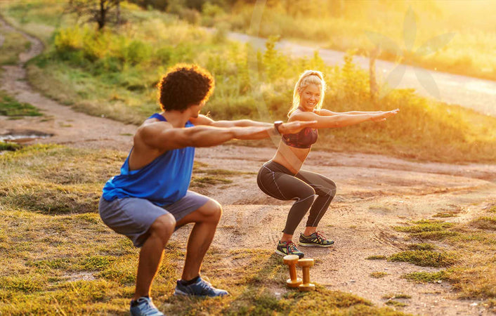 Man and woman practising low-impact exercises in nature