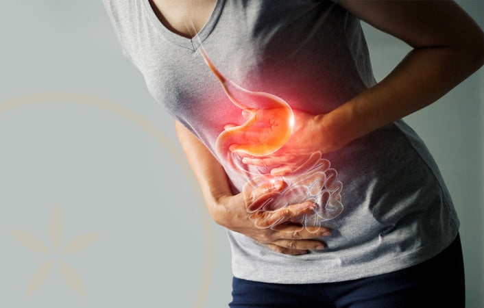 Woman in pain as a result of gut health problems