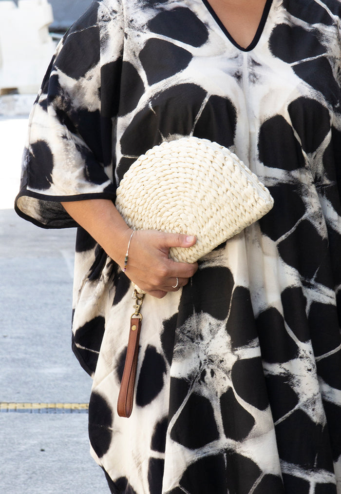 Just Gaya's Half-moon Woven Clutch
