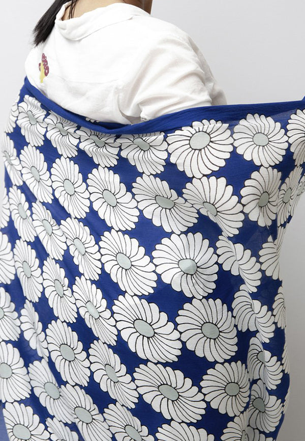 white and grey marigold pattern repeated on deep dark blue