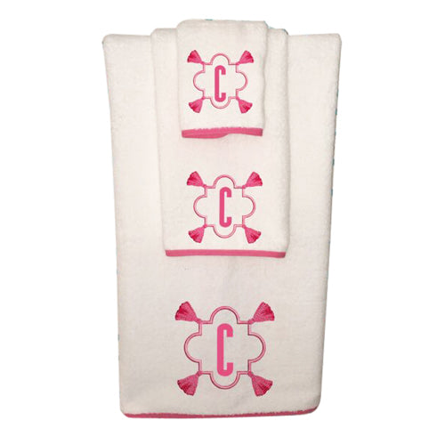 White towel with pink monogram