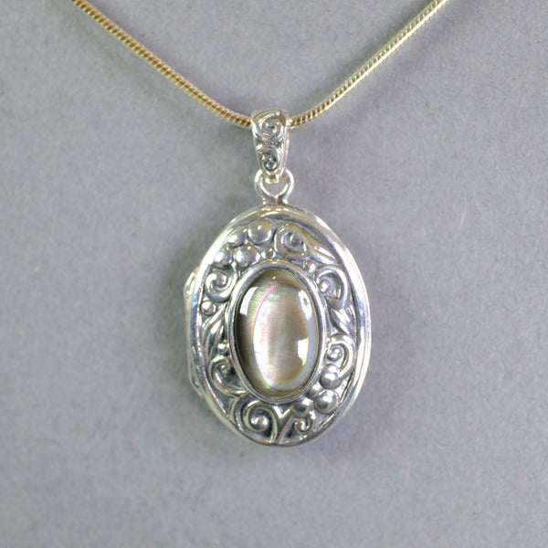 Silver and Abalone Shell Locket.