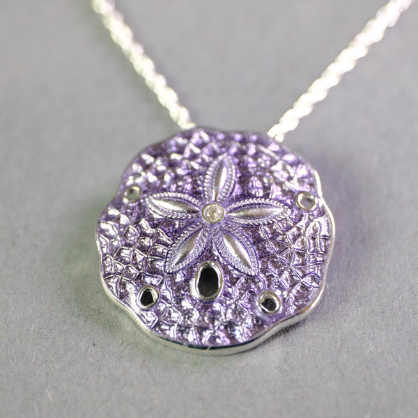 Silver and Enamel Purple Sand Dollar Pendant.