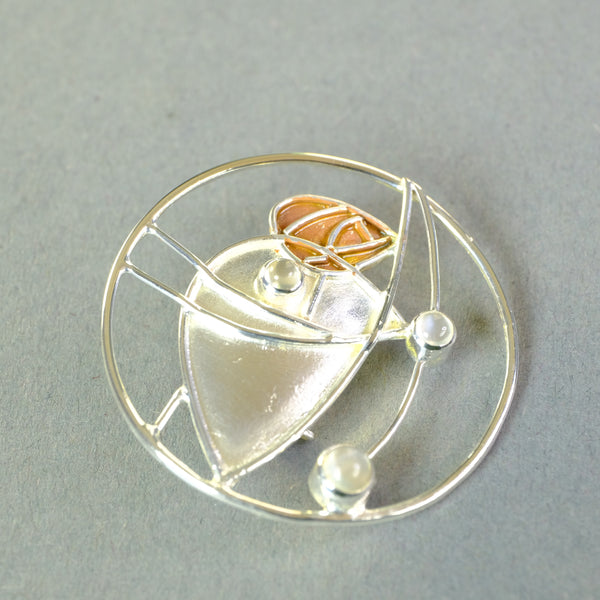 Silver and Moonstone Brooch by Paula Bolton, in a Mackintosh Design.