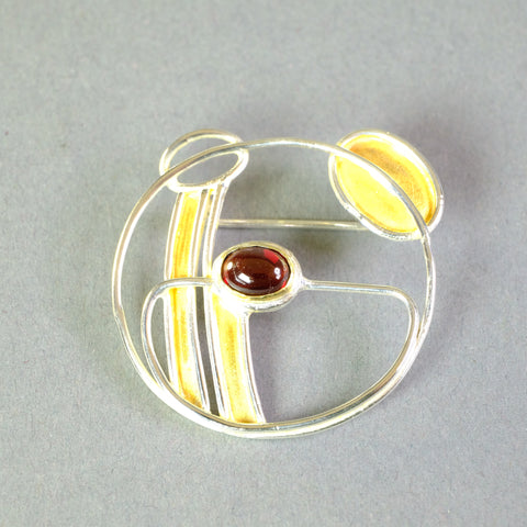 Silver and Garnet Brooch by Paula Bolton, in a Mackintosh Design.