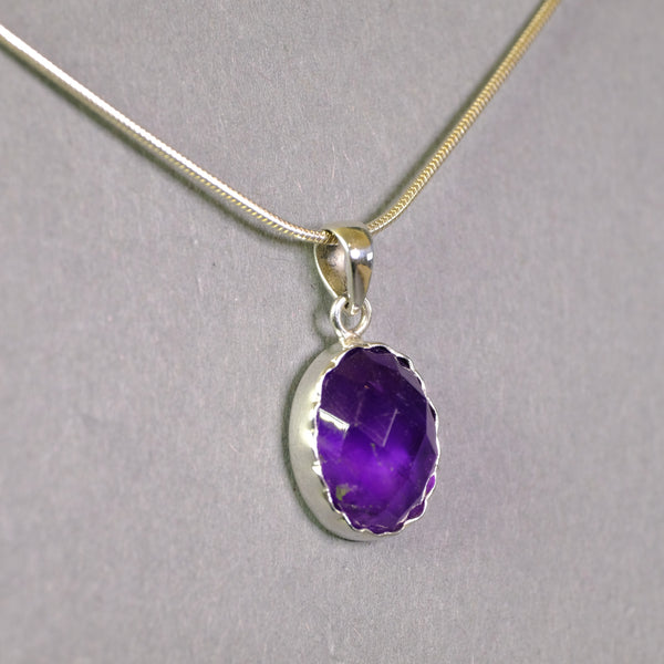 Faceted Amethyst and Silver Pendant.