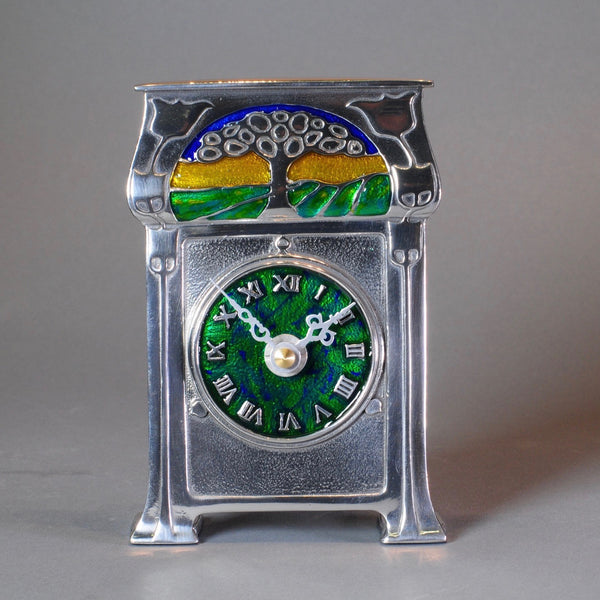 Pewter and Enamel Mantel clock, Archibald Knox Design.