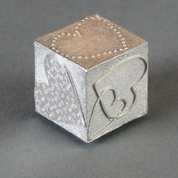 A Solid Pewter 'Love' Cube