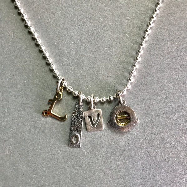 Handmade Silver by Nick Hubbard 'Love Charms' Pendant.
