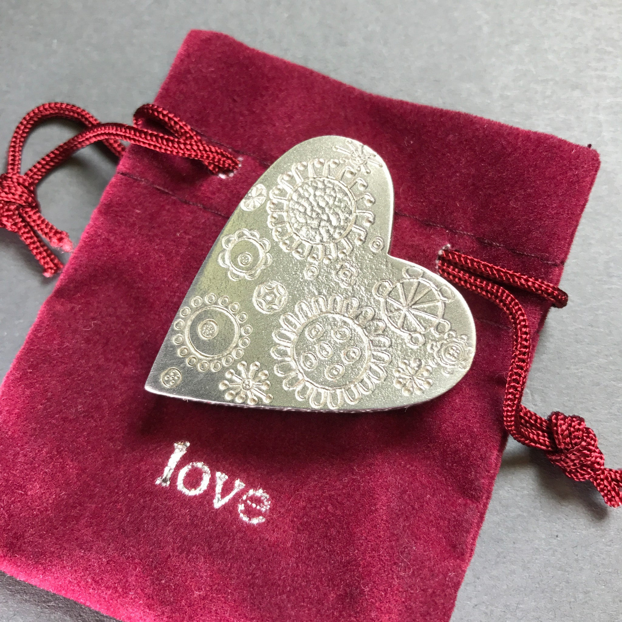 A Solid Pewter 'Love Token'