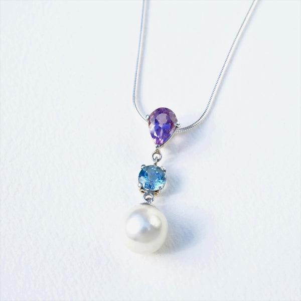 Silver, Mabe Pearl, Blue Topaz and Amethyst Pendant.