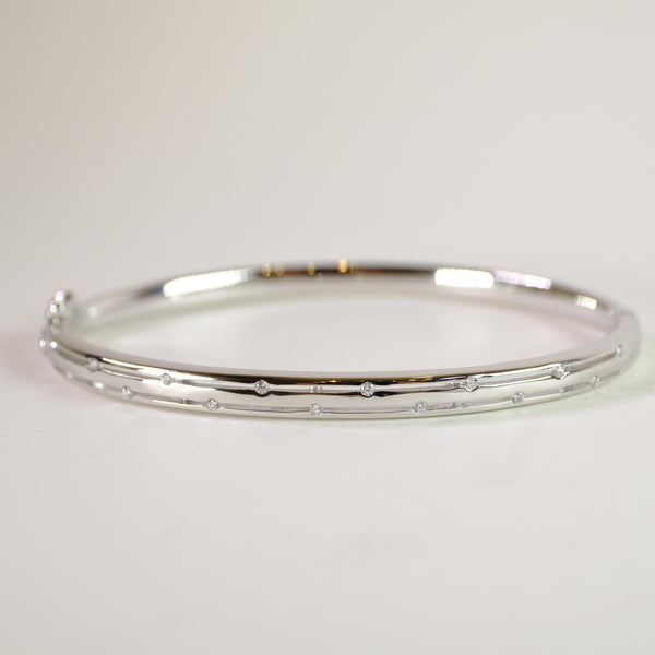 Sterling Silver Bangle set with CZ stones by LBJ Designs.