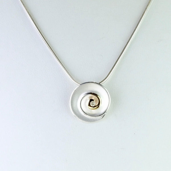 Silver, Gold and Daimond Pendant by JB Designs.