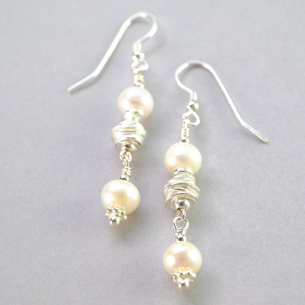 Silver and Pearl Drop Earrings.
