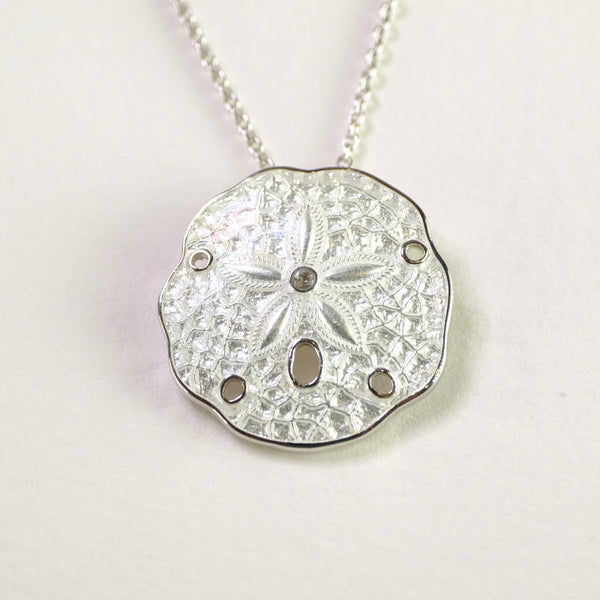 Silver and Enamel White Sand Dollar Pendant by Nicole Barr.