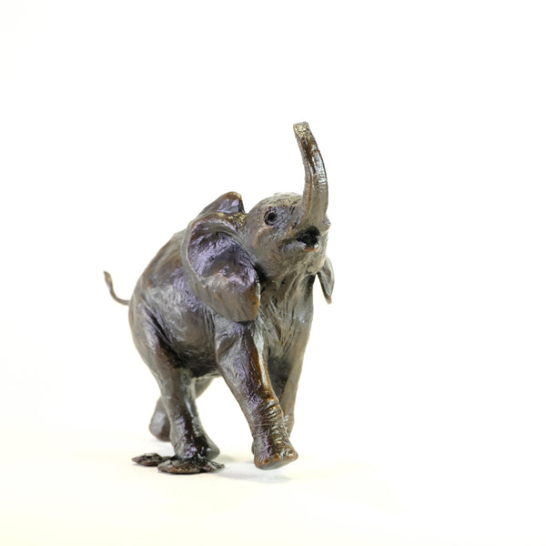 Bronze 'Baby Elephant Running Trunk Up' by Michael Simpson.