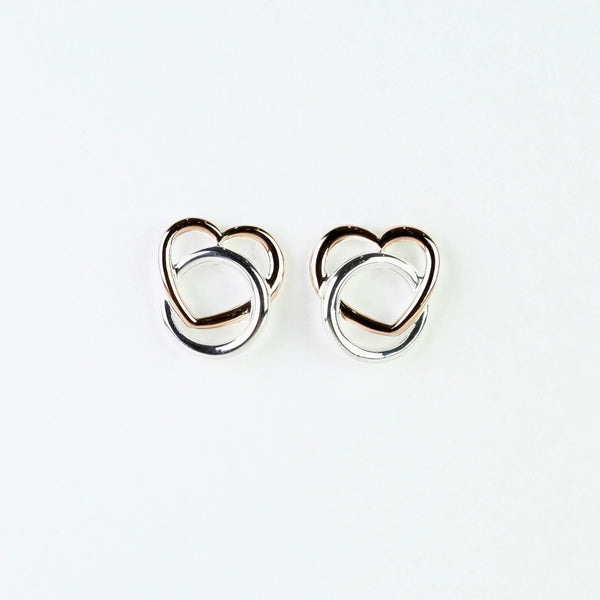 Silver and Rose Gold Heart Stud Earrings by 'Unique'