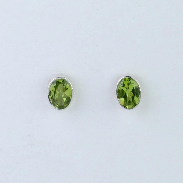 Oval Silver and Peridot Stud Earrings.