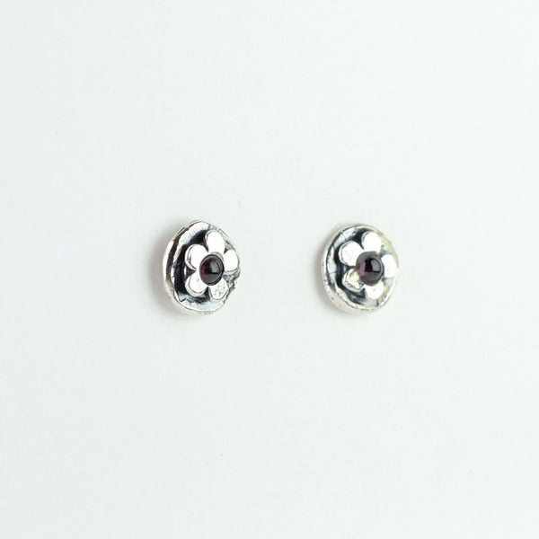 Garnet and Silver Flower Stud Earrings.