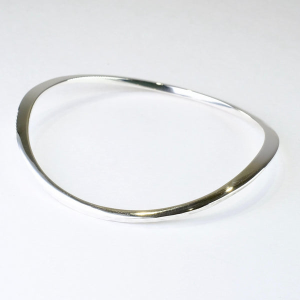 Curved Sterling Silver Bangle.