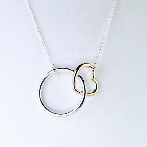 Circle and Silver Heart Necklace.