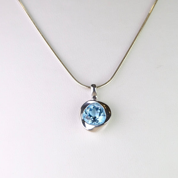 Blue Topaz and Silver Pendant.