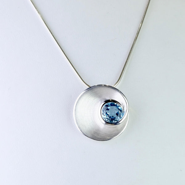 Blue Topaz and Satin Silver Pendant by JB Designs.