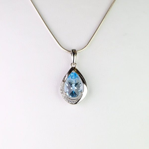 Blue Topaz, Cubic Zirconia and Silver Pendant.