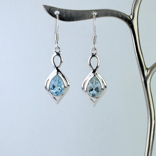 Silver and Faceted Blue Topaz Drop Earrings.