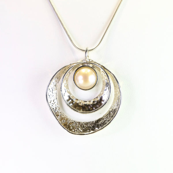 Textured Silver and Pearl Circle Pendant.