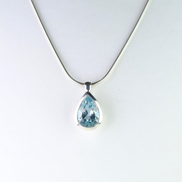 Tear Drop Blue Topaz and Silver Pendant.
