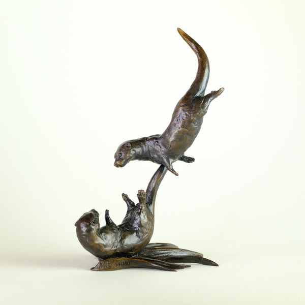 Bronze 'Otters Tumbling' by Michael Simpson.