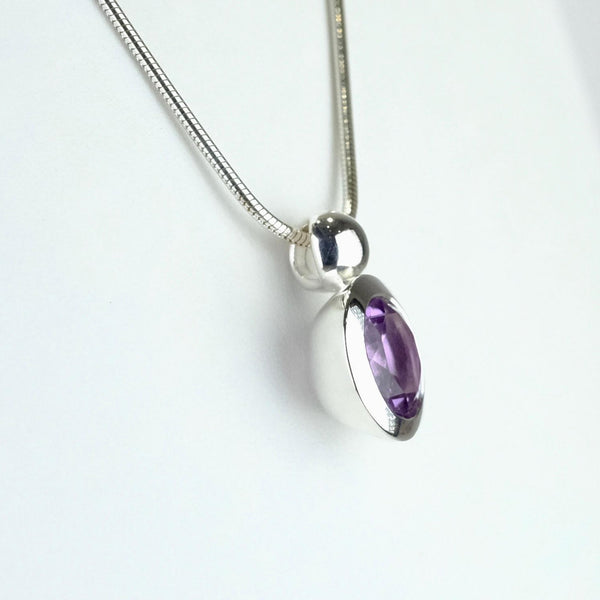 Round Amethyst and Silver Pendant.