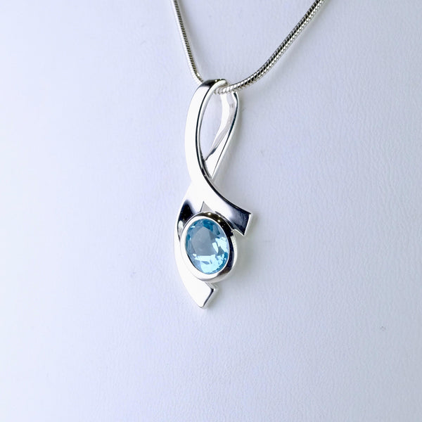 Organic Shape Blue Topaz and Silver Pendant.