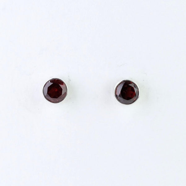 Round Silver and Garnet Stud Earrings.