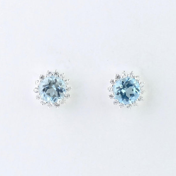 Silver, Blue Topaz and CZ Stud Earrings by JB Designs.