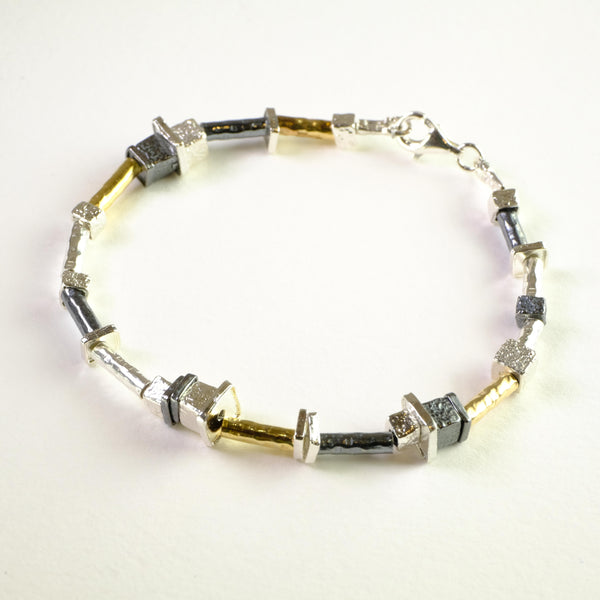 Silver and Rolled Gold Linked Bracelet by LBJ Designs.