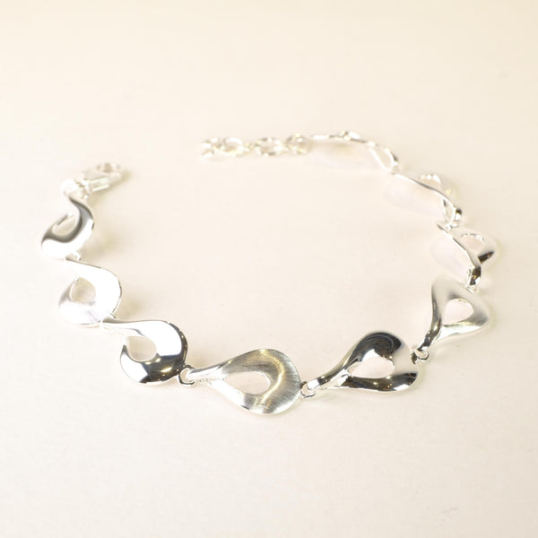 Satin and Polished Silver Linked Bracelet by JB Designs.