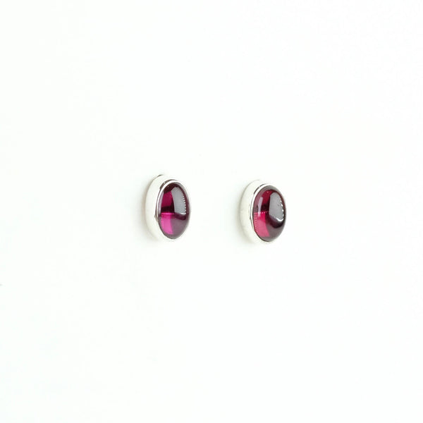Oval Silver and Garnet Stud Earrings.
